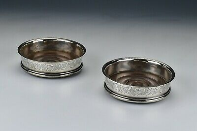 Pair of Early  English Sterling Silver Grape Pattern Wine Coasters London