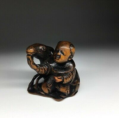 antique Japanese fine carved wood Netsuke of a Karako And Goat, 19th c Meiji Edo