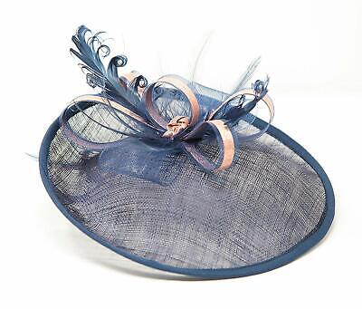 Navy blue and rose gold hatinator style fascinator on a clip comb and Alice band