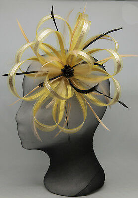 New big gold and black fascinator on a clip comb and Alice band