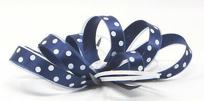 Navy blue and white polka dot fascinator with comb, clip, & alice band.