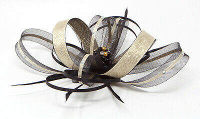 Black and metallic gold fascinator with diamantè with comb, clip, & alice band.