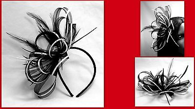 Black and white fascinator with diamante' detail on a comb, Alice band or clip.