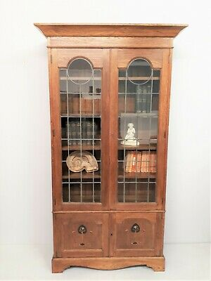 British Arts & Crafts oak inlaid tall bookcase