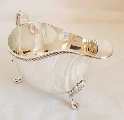 Antique sterling silver sauce / gravy boat .Sheffield 1976 .By Henry Hutton Co.