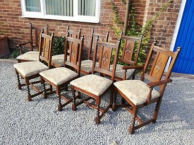 Rare set of 8 Old Charm oak carved dining chairs