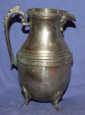 Antique ornate silver plated footed milk jug creamer pitcher