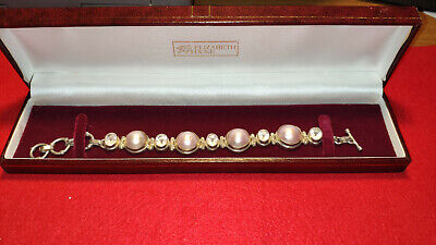 Silver bracelet with stones in box