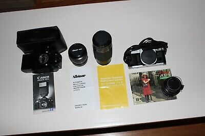 Canon AE-1 Program 35mm Manual SLR Camera with 50mm 1:1.8 Lens and other lens