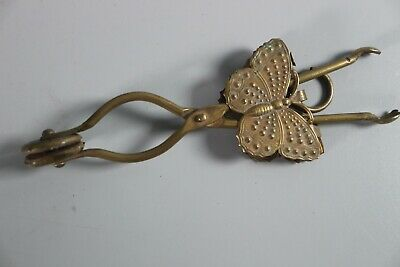 Antique Victorian Brass Skirt Lifter with Butterfly
