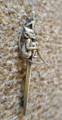 Antique sterling silver pixie in a moon brooch