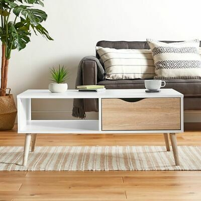 White and Oak coffee table on-trend tapered legs modern design draw open shelf