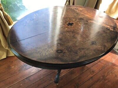 A Victorian Walnut Table With Inlaid Oval Top