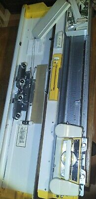 Singer 321 knitting machine with accessories