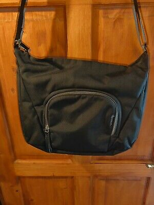 Used Crumpler Camera Messenger Bag in black with green and grey interior.