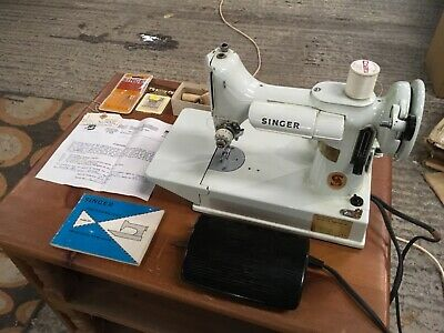 A lovely old Singer Featherweight 221K Sewing Machine  Model with Case etc