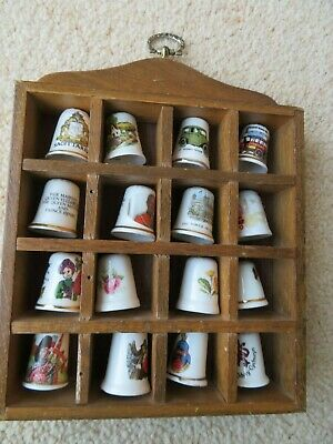 Collection of 18 porcelain/bone china thimbles in wooden display case