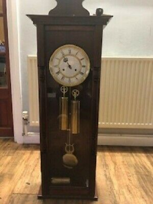 Antique longcase grandfather clock, hangs on the wall