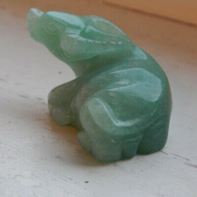 A good Chinese green jade carving of a seated buffalo or ox