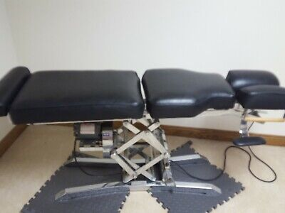 Used Chiropractic hi low table black vinyl  great condition motor works great!!