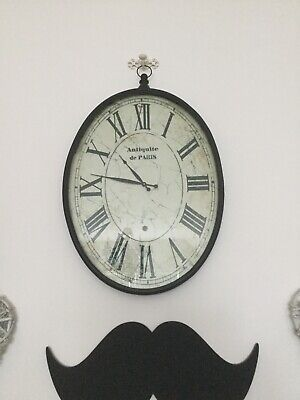 Large oval antique effect wall clock fully working order in super condition