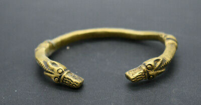 Viking brass alloy bracelet with two wolves head terminals 9th-10th century ad