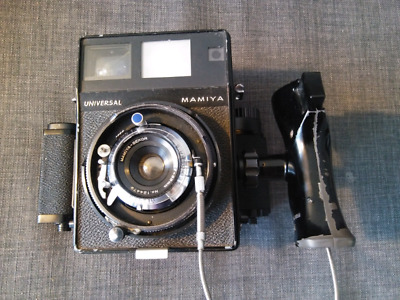 Mamiya Press Universal with 65mm lens and two backs.