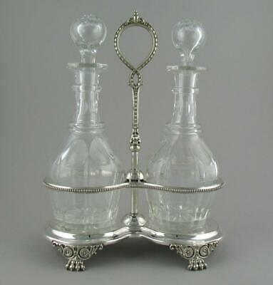 Antique Victorian Silver Plated Bottle Stand Tantalus Pair Facet Cut Decanters