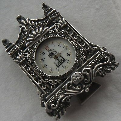 Mason Small clock 59 mm. x 46 mm.aside silver carved case, stem missing