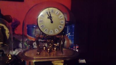 Vintage torsion anniversary 400 day wind-up mechanical mantel clock under perple