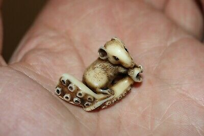 Antique Japanese Netsuke of a rat on an octopus tentacle.