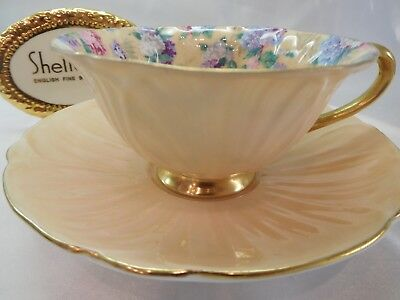 Shelley Ivory Summer Glory Chintz  Oleander Footed  Cup And Saucer  Gold Trim
