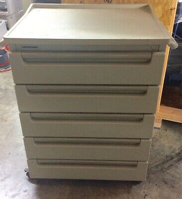 Midmark 6067 mobile treatment cart.  Good condition, guaranteed