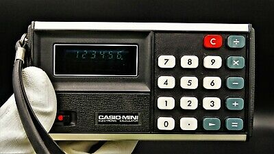 Antigua calculadora CASIO MINI CM-603 con funda original y funcionando, año 1973
