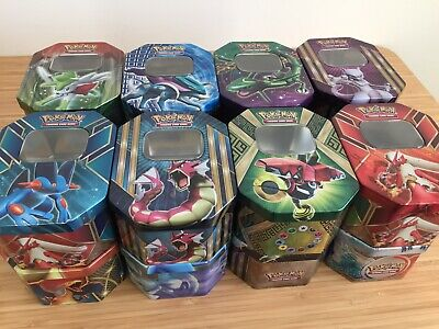 50 mint pokemon cards with 7 shiny/holo and many rare's in tin. Birthday gifts.