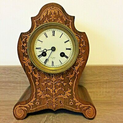 A Small French Rosewood Mantel Clock