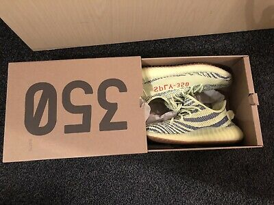 Pair of lime green adidas yeezy boost 350 in box