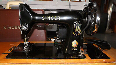 vintage electric SINGER sewing machine for parts or repair, with lockable case.