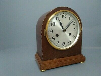 Philip Haas & Son Oak Cased striking mantle clock.
