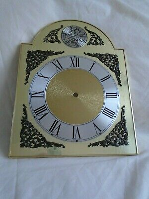 A brassed break arch clock dial, pre-owned.