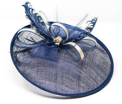 Navy blue and gold hatinator style fascinator on a clip comb and Alice band