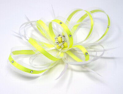 Lime and white fascinator with diamanté on a comb, clip and alice band …