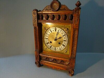 German Mahogany striking mantle table clock.