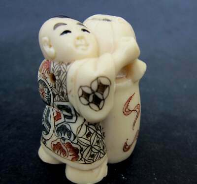 Japanese ivory color bone  netsuke -Boy Bartender Has Wine Barell of Wine