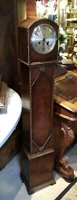 Antique granddaughter clock, circa 1900s, chimes on a gong, eight day movement