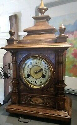 Antique mantle clock by H A C, eight day, strikes on a gong, pretty case