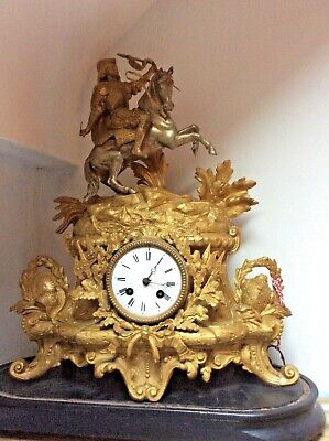 Antique French Mantle Clock  Soldier on horseback. Gold finish very rear clock
