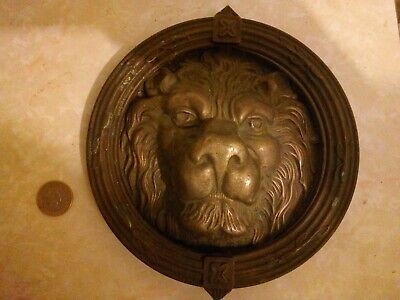 A massive brass lion's head doorknocker in fine condition.