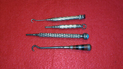 Two propel pencyls and two old Victorian tide hooks