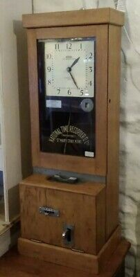 Antique clocking in machine, electric, fully working, wall or floor standing,